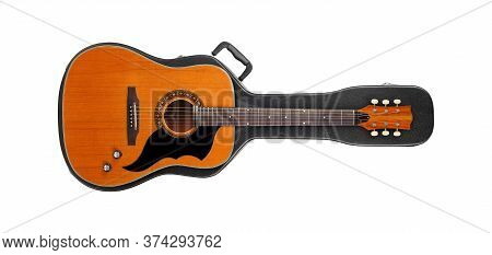 Musical Instrument - Vintage Western Guitar From Above On A Hard Case Isolated On A White Background