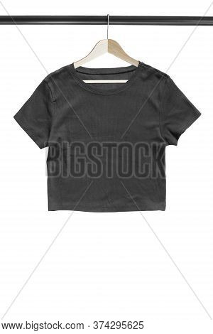 Black Basic Crop Top Hanging On Wooden Clothes Rack Isolated Over White