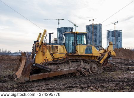 Track-type Bulldozer During Of Large Construction Jobs At Building Site. Land Clearing, Grading, Poo