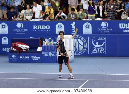 KUALA LUMPUR - SEP 28: Kei Nishikori (Japan) waves to the crowd after his quarter-final match at the ATP Tour Malaysian Open 2012 on September 28, 2012 at the Putra Stadium, Kuala Lumpur, Malaysia.