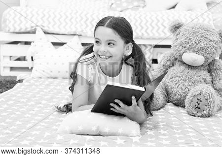 Once Upon A Time. Girl Child In Bed Read Book With Teddy Bear Plush Toy. Pleasant Time In Cozy Bedro