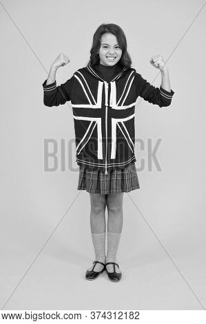 Real Confidence. Vacation In Great Britain. Travel Concept. Union Jack Flag. Small Girl Uniform. Kid