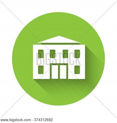White School Building Icon Isolated With Long Shadow. Green Circle Button. Vector Illustration