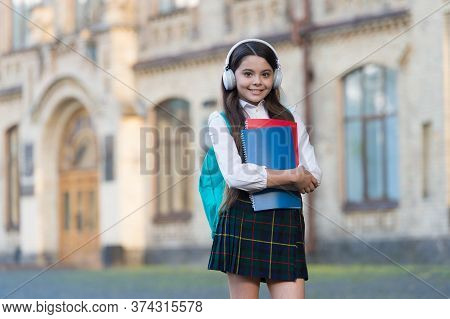 Audio Technology. Happy Child Wear Audio Headphones. Audio Educational Media. Listening Comprehensio