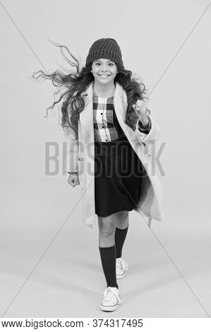 Stylish Schoolgirl Go Forward. Go To School. Happy Pupil Kid Yellow Wall. Back To School. Desire For