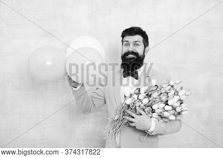 Bearded Man With Tulips. Guy With Air Balloons. Birthday Party. Bearded Man Hipster With Flower Bouq