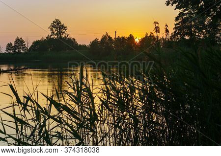Sunset On The Lake, The Sun Sets Over The Horizon