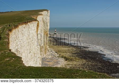Lighthouse And Sea At Beachy Head Chalk Cliffs In The South Downs Near Eastbourne, East Sussex, Engl