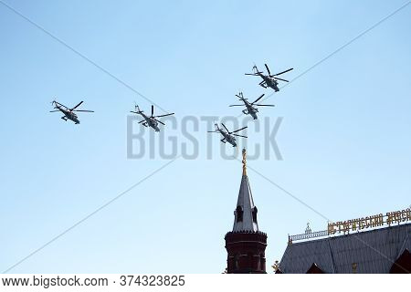 Moscow, Russia - June 24,2020. An Air Parade Of Military Combat Helicopters Of Russian Air Force Fly
