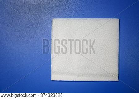 Blank Paper Napkin Isolated On Blue Background With Copy Space . White Napkin On Blue Background, Ma