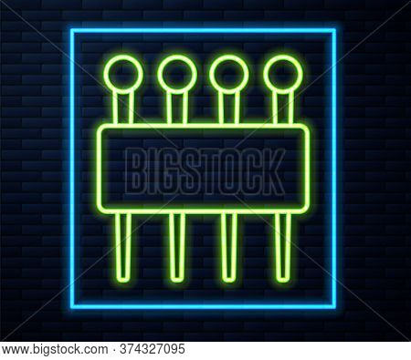 Glowing Neon Line Needle For Sewing Icon Isolated On Brick Wall Background. Tailor Symbol. Textile S
