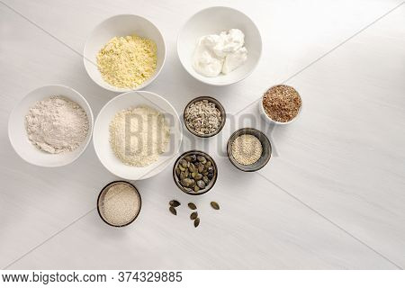 Baking Ingredients For A Healthy Low Carb Protein Bread With Quark, Oat Bran, Almond Flour And Vario
