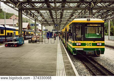 Lauterbrunnen, Berner Oberland, Switzerland - July 28 2019 : Green And Yellow Train Of The Wengernal