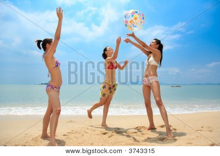 Woman Friends Playing At The Beach