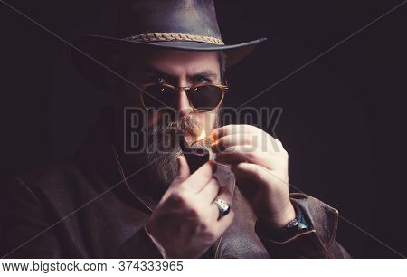 Menacing Vintage Cowboy Standing With Pipe For Smoking.