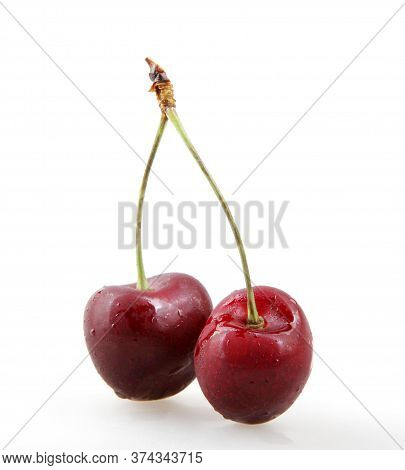 Sweet Cherry Isolated On White Background. A Cherry Is The Fruit Of Many Plants Of The Genus Prunus,
