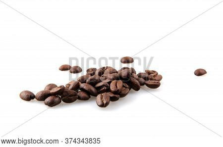 Coffee Beans Isolated On White Background. A Coffee Bean Is A Seed Of The Coffea Plant And The Sourc