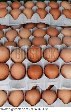 Many Light Brown Eggs In A Paperbox.