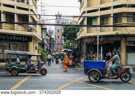 Bangkok, Thailand - July 14, 2020 : Bangkok City Lifestyle. Buddhist Monk Walking Across Alley While