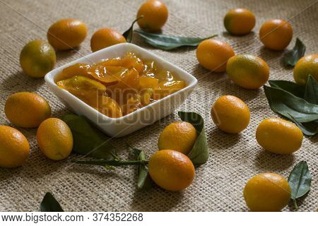 Home Made Kumquat Jam And A Lot Of Kumquat On A Table.