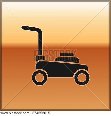 Black Lawn Mower Icon Isolated On Gold Background. Lawn Mower Cutting Grass. Vector