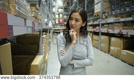 Shopping Concept. An Asian Woman Is Walking To Buy Furniture In A Warehouse. 4k Resolution.