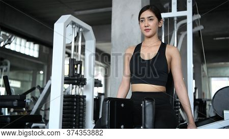 Fitness Concept. An Asian Woman Is Exercising Her Thighs In The Gym. 4k Resolution.