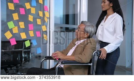 Business Concepts. An Old Wheelchair Person Is Writing A Message On The Mirror. 4k Resolution.