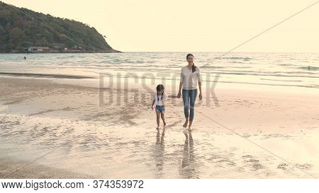 Family Concept. Mother Holding Her Daughter To Walk By The Sea. 4k Resolution.