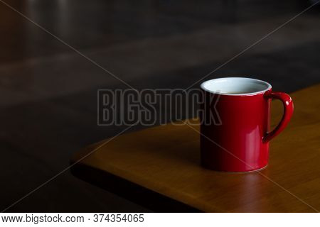 Mug Of Hot Americano Black Coffee On The Top Of The Wooden Table With Morning Light At The Coffee Sh