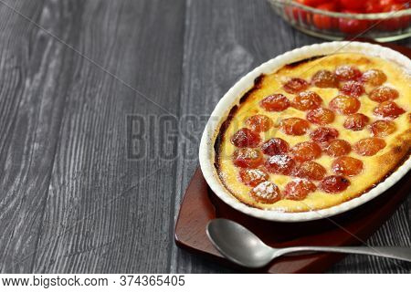 traditional cherry clafoutis, contains pits of the cherries