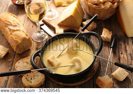traditional french cheese fondue with bread