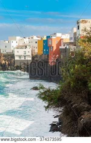 View On Colorful Buildings On The Rock Over The Ocean In Punta Brava, Puerto De La Cruz, Tenerife, C