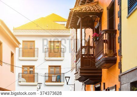 Bright Sun Over Colorful Buildings On A Narrow Street In Spanish Town Punto Brava, Tenerife, Canary