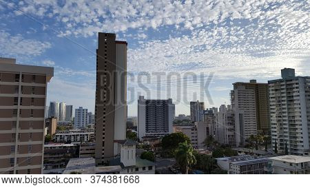 Makiki, And Honolulu Cityscape Looking To The Ocean From High Up With Houses And Modern Highrises, A