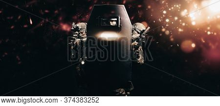 Portrait Of A Group Of Fighters Of A Special Unit. They Hide Behind A Bulletproof Shield. Background