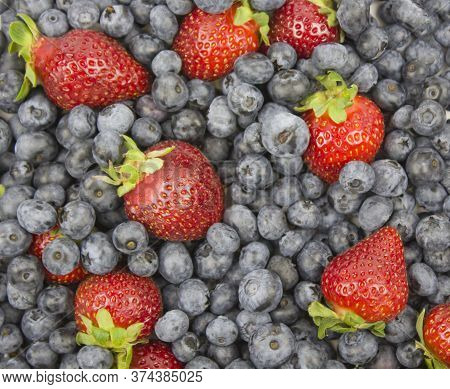 Fresh Fruits. Healthy Food. Mixed Fruit, Strawberries And Blueberries, Peaches. Organic Healthy Asso