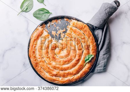 Filo Spinach And Feta Twist Pie In The Iron Pan After Oven. Authentic Greek Bakery. With Spinach, Mi