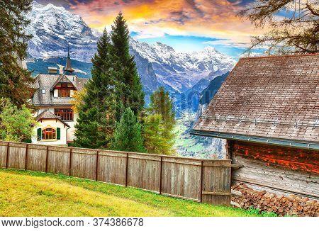 Fantastic Autumn View Of Traditional Swiss Chalets In Wengen Village. Picturesque Alpine Village Wen