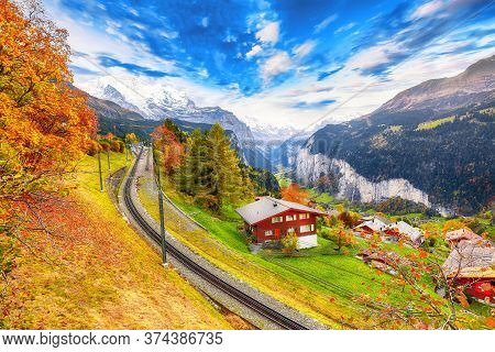 Fabulous Autumn View Of Picturesque Alpine Village Wengen And Lauterbrunnen Valley With Jungfrau Mou