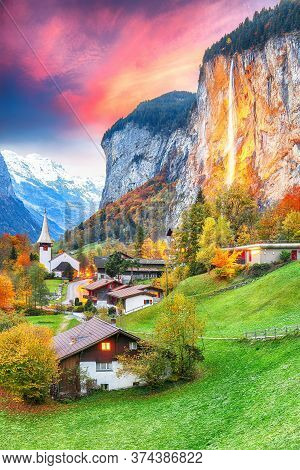 Captivating Autumn View Of Lauterbrunnen Valley With Gorgeous Staubbach Waterfall And Swiss Alps At