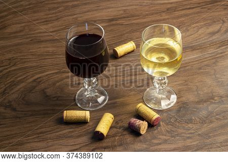 Two Glasses Of Wine On The Table, Red Wine And White Wine..