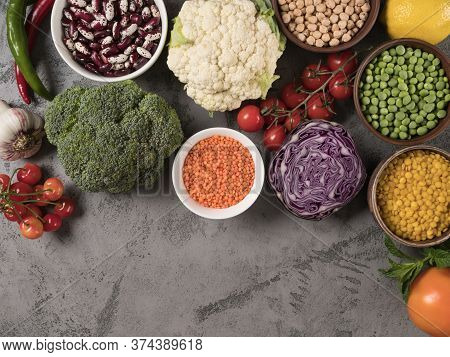 Set Of Fresh Vegetables, Fruits And Legumes On A Gray Background.