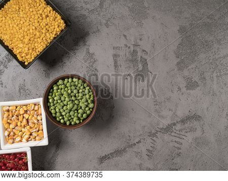Red, Yellow, And Green Ingredients For Cooking. Beans On A Grey Background.