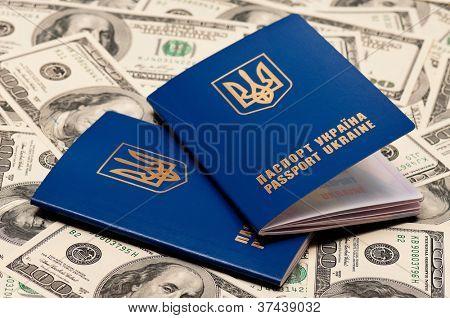 Two international Ukrainian passport on US dollars background