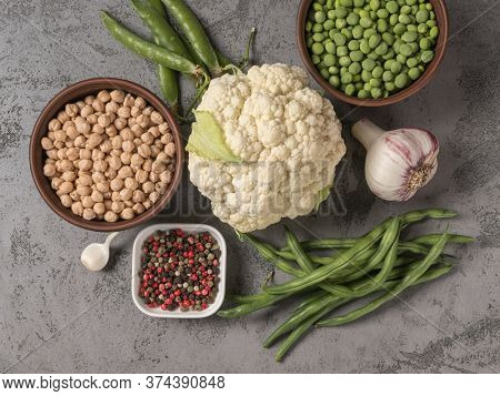 The Concept Of Healthy Eating. The Gray Background. Organic Vegetables And Beans.