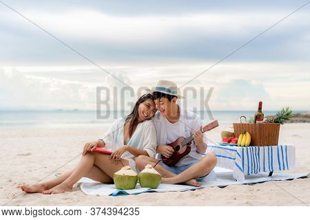 Asian Couple Happy And Enjoy The Trip Honeymoon Of Couple Lover On The Sea Beach By Playing Ukulele