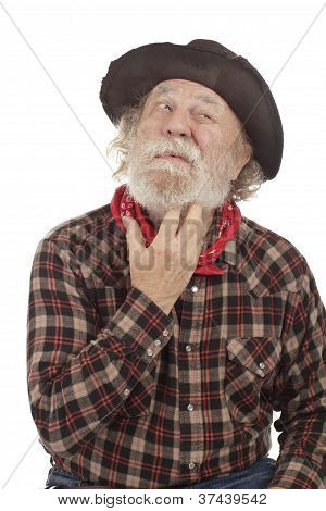 Old Cowboy Thinks And Scratches Whiskers