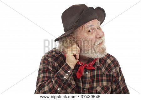Old West Cowboy Pulls On Ear And Thinks Of Idea