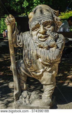 Austria, Salzburg, 09,03,2011. Statue Of A Dwarf From The Garden Of The Dwarfs Of Mirabel Park. Dwar